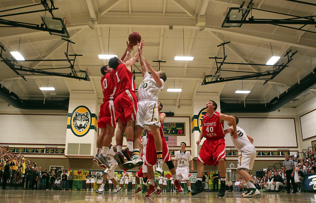 . Monte Vista\'s Anders Turner (1) and San Ramon Valley\'s Jet Reed (30) go for the rebound in the first half of their varsity boys basketball game in Danville, Calif., on Friday, Feb. 15, 2013. (Anda Chu/Staff)