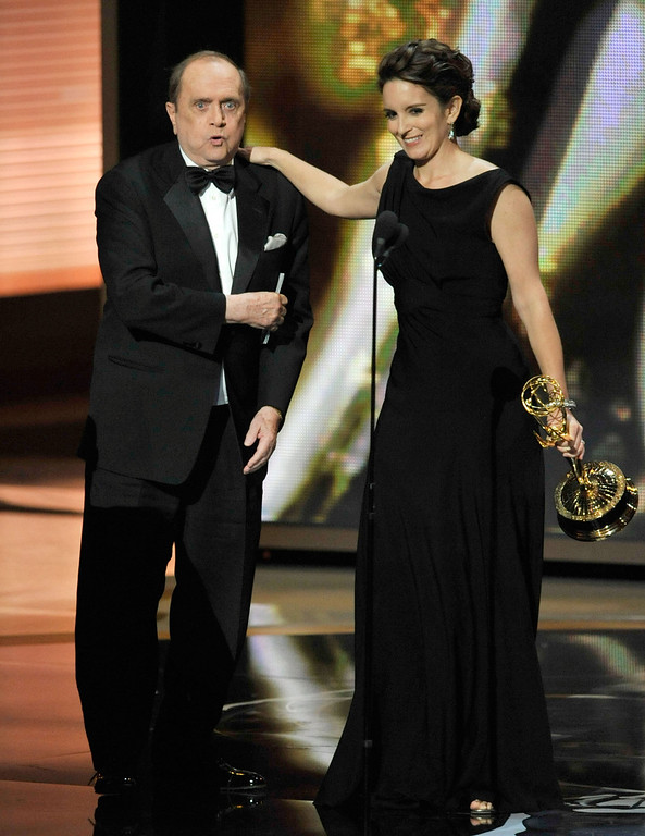 """. Actor Bob Newhart presents the Outstanding Comedy Series award to actress Tina Fey for \""""30 Rock\"""" onstage during the 61st Primetime Emmy Awards held at the Nokia Theatre on September 20, 2009 in Los Angeles, California.  (Photo by Kevin Winter/Getty Images)"""