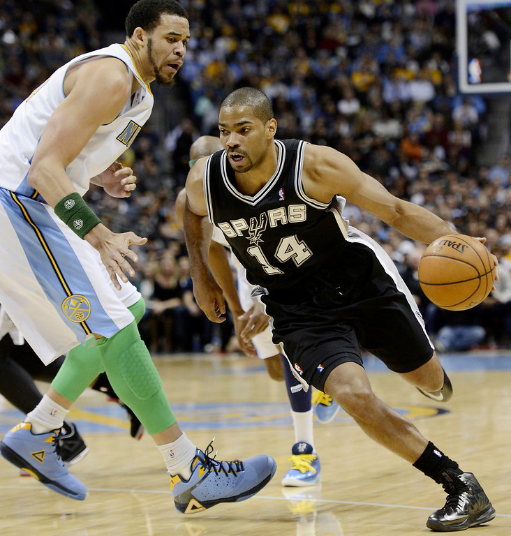 . San Antonio Spurs GAry Neal (14) drives on Denver Nuggets Javale McGee (34) during the first quarter April 10, 2013 at Pepsi Center. (Photo By John Leyba/The Denver Post)