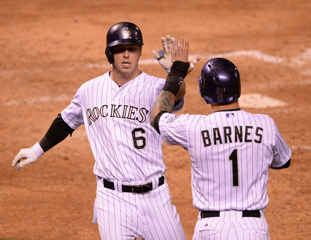 . DENVER, CO - APRIL 18: Colorado base runners Ryan Howard and Brandon Barnes both scored on a Wilin Rosario double in the eighth inning. The Colorado Rockies defeated the Philadelphia Phillies 12-1 Friday night, April 18, 2014 at Coors Field.  (Photo by Karl Gehring/The Denver Post)