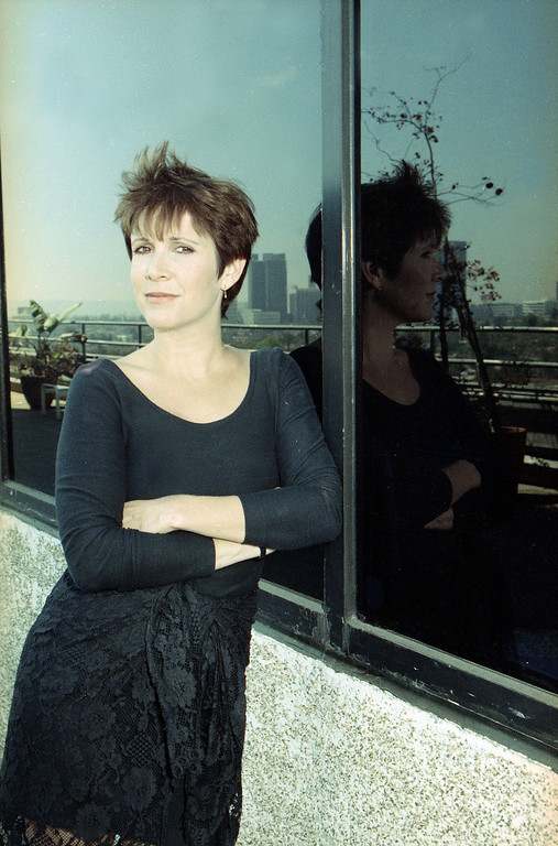. Actress and author Carrie Fisher is seen in Beverly Hills, Calif., Sept. 14, 1990.  (AP Photo/Julie Markes)