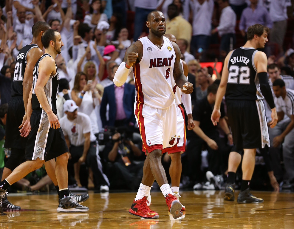 . LeBron James #6 of the Miami Heat reacts after defeating the San Antonio Spurs 103-100 in overtime in Game Six of the 2013 NBA Finals at AmericanAirlines Arena on June 18, 2013 in Miami, Florida.  (Photo by Mike Ehrmann/Getty Images)