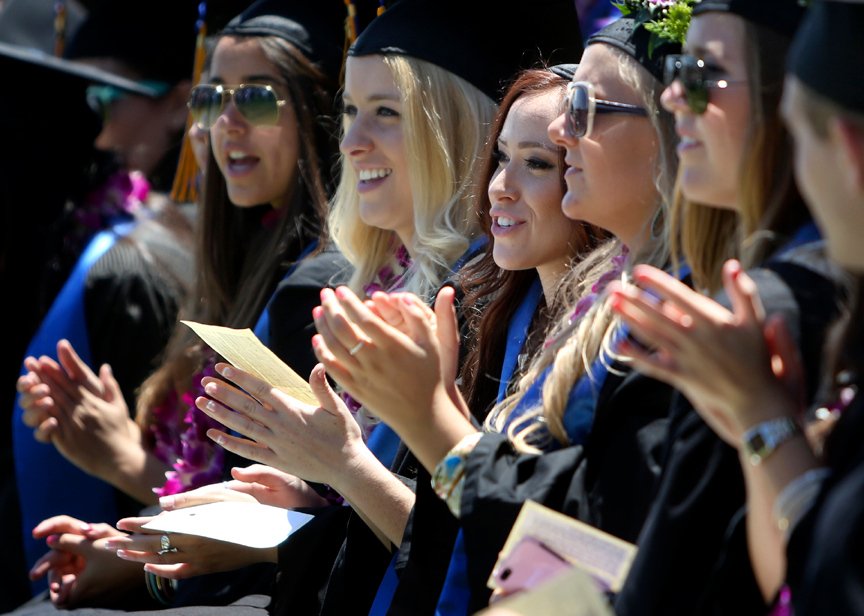 . UCSC seniors applaud for a speaker as they wait to graduate from College Eight at the lower west field on Saturday. (Kevin Johnson/Sentinel)
