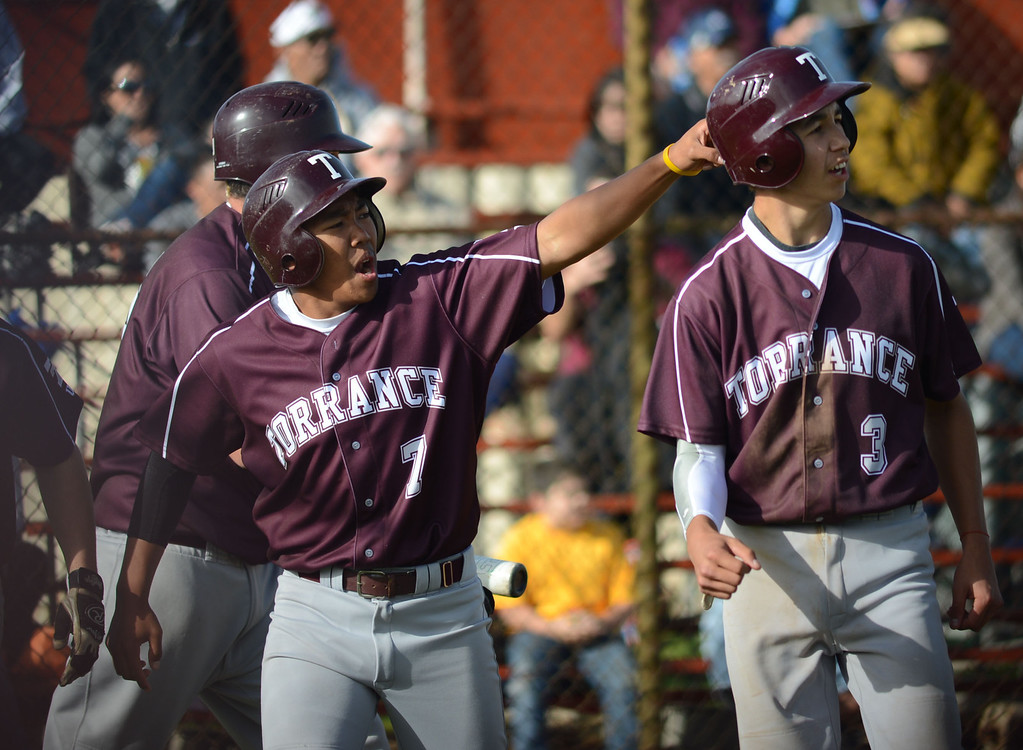 . Torrance\'s Kyle Ulanday (7) celebrates the three runs scored on a double by Tyler Martizia (5) in a non league baseball game at West. After a scoreless game through five, West went on to win 7-4. 20130314 Photo by Steve McCrank / Staff Photographer