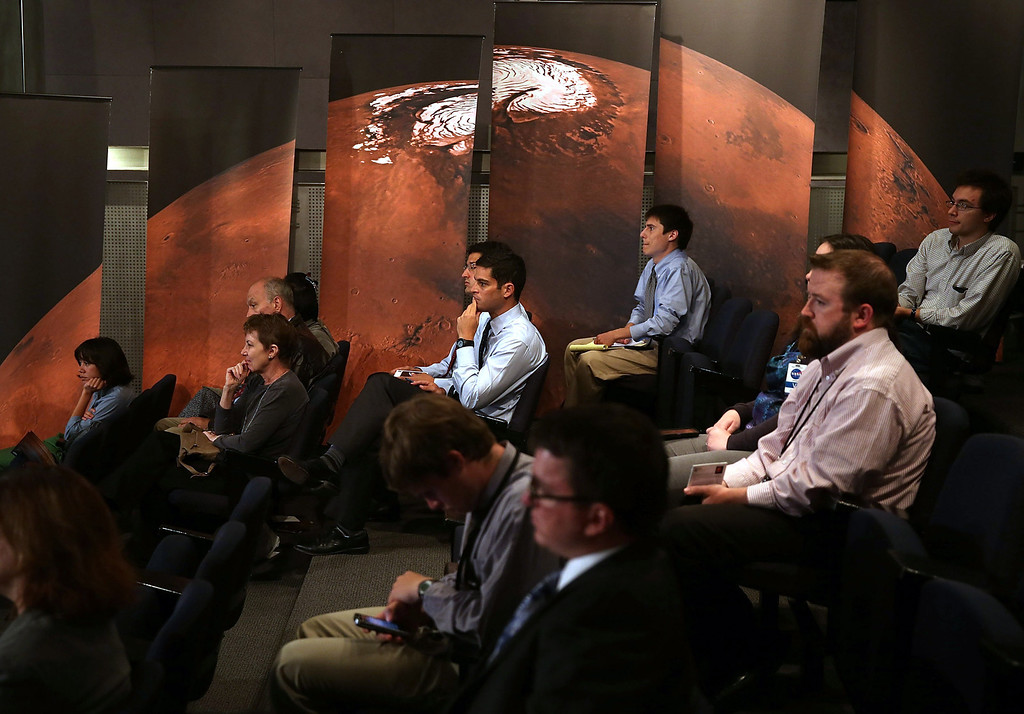 . WASHINGTON, DC - AUGUST 06:  People listen to NASA Administrator Charles Bolden speak about the Curiosity rover during an event at NASA headquarters, August 6, 2013 in Washington, DC. The event was held to observe the first anniversary of NASA\'s Curiosity rover landing on Mars.  (Photo by Mark Wilson/Getty Images)