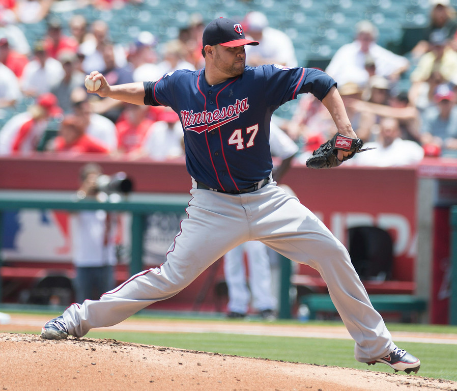 . The Minnesota Twins\' Ricky Nolasco makes a pitch as they play the Angels at Angel Stadium in Anaheim on Thursday June 26, 2014. (Photo by Keith Durflinger/Whittier Daily News)