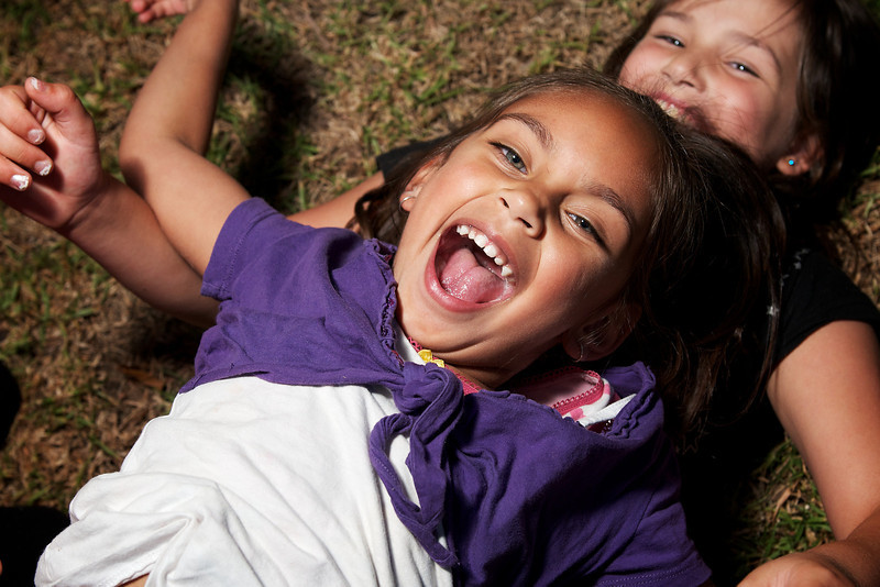 Aboriginal Girl laughing with Caucasian Girl