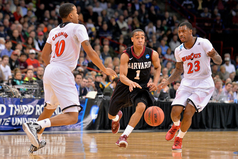 March 20, 2014: Harvard Crimson guard Siyani Chambers (1) brings the ball up the court on a fast break during a second round game of the NCAA Division I Men's Basketball Championship between the 5-seed Cincinnati Bearcats and the 12-seed Harvard Crimson at Spokane Arena in Spokane, Wash. Harvard defeated Cincinnati 61-57.