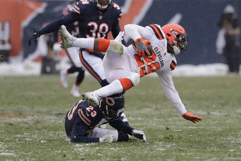 . Chicago Bears cornerback Kyle Fuller (23) brings down Cleveland Browns running back Duke Johnson (29) in the second half of an NFL football game in Chicago, Sunday, Dec. 24, 2017. (AP Photo/Nam Y. Huh)