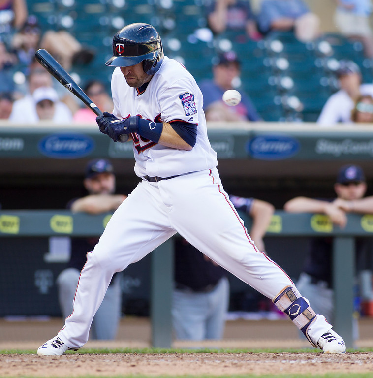 . Minnesota Twins\' Brian Dozier (2) is hit by a pitch during the seventh inning of a baseball game against the Cleveland Indians, Sunday, Sept. 11, 2016, in Minneapolis. Cleveland won 7-1. (AP Photo/Paul Battaglia)