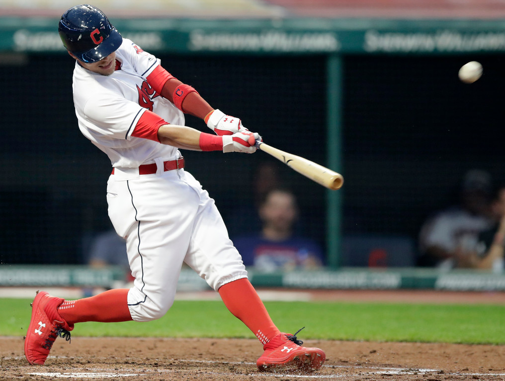. Cleveland Indians\' Brandon Guyer hits a two-run home run off Minnesota Twins starting pitcher Kyle Gibson in the fourth inning of a baseball game Monday, Aug. 6, 2018, in Cleveland. Roberto Perez also scored on the play. (AP Photo/Tony Dejak)