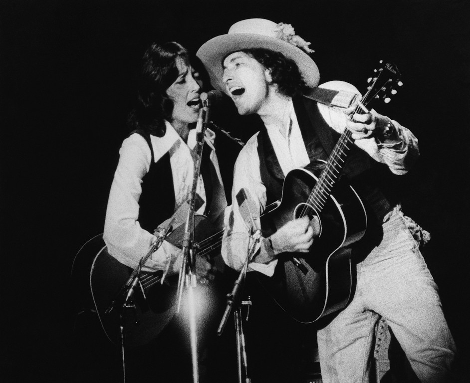 . Bob Dylan is back on the road with his show visiting small town and cities.  He is seen here with Joan Baez, Nov. 4, 1975 in Providence, R.I. (AP Photo)