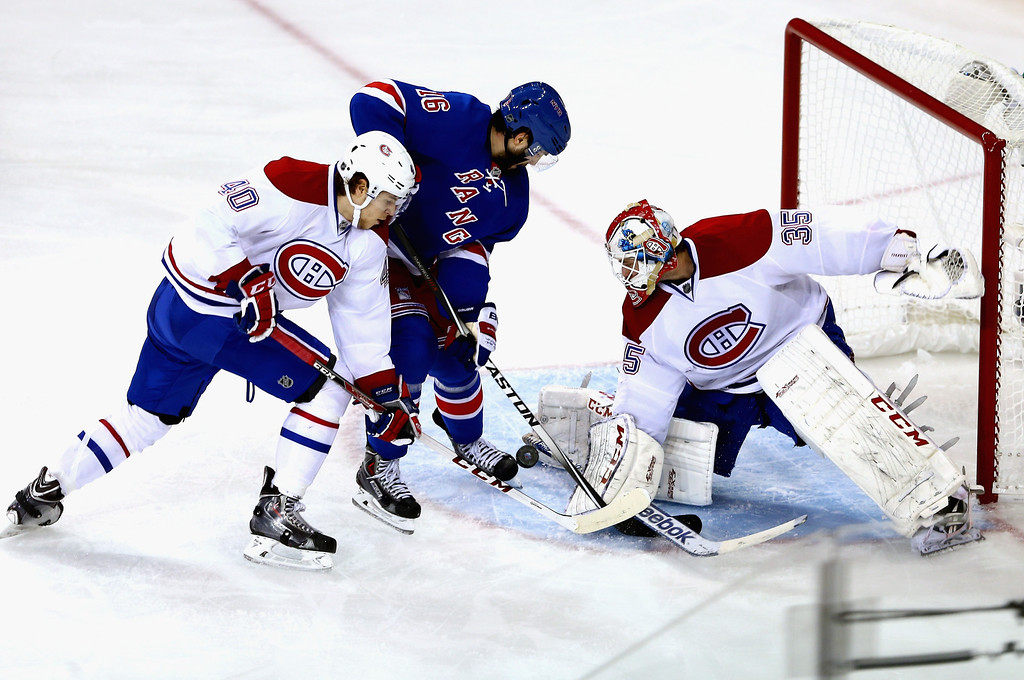 . Dustin Tokarski #35 of the Montreal Canadiens makes a save against Derick Brassard #16 of the New York Rangers during Game Six of the Eastern Conference Final in the 2014 NHL Stanley Cup Playoffs at Madison Square Garden on May 29, 2014 in New York City.  (Photo by Elsa/Getty Images)