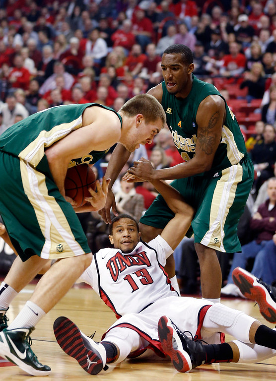 . UNLV\'s Bryce Dejean-Jones (13) and Colorado State\'s Pierce Hornung, left, and Greg Smith, right, struggle for a loose ball during the first half of an NCAA college basketball game on Wednesday, Feb. 20, 2013, in Las Vegas. UNLV defeated Colorado State 61-59. (AP Photo/Isaac Brekken)