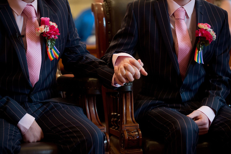 ". Phil Robathan (L) and James Preston (R) hold hands during their wedding ceremony in Brighton, southern England, on March 29, 2014. Gay couples across England and Wales said ""I do\"" as a law legalizing same-sex marriage came into effect at midnight, the final stage in a long fight for equality.  (LEON NEAL/AFP/Getty Images)"