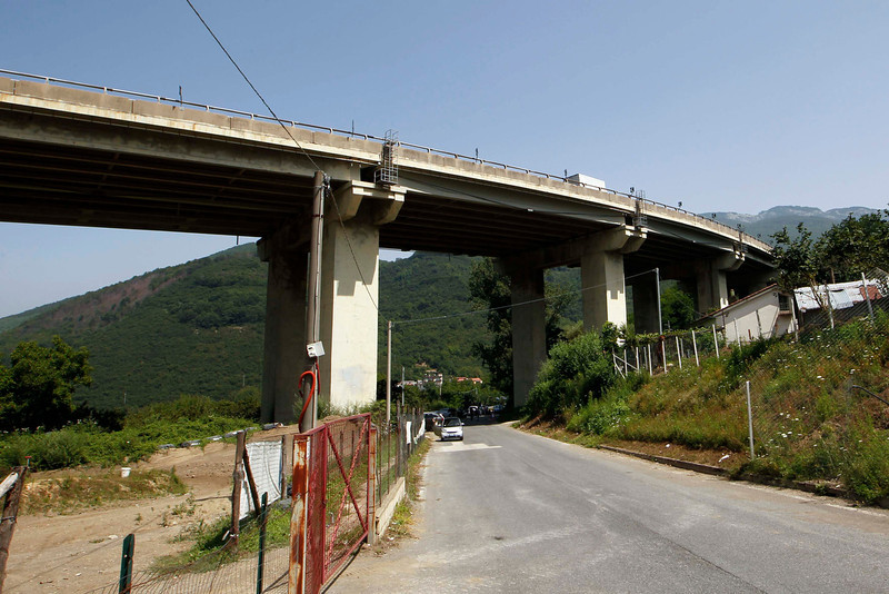 . The viaduct where a coach plunged off is seen near the southern town of Avellino July 29, 2013. Thirty-nine people were killed and around 10 injured when a bus plunged off a viaduct in southern Italy in what Prime Minister Enrico Letta described on Monday as a huge tragedy. Initial reports suggested that the coach was travelling at speed and had hit four or five cars before crashing over the roadside barriers on a stretch of road near Monteforte Irpino, east of Naples, on Sunday night. There were around 50 people on board, including many children. REUTERS/Ciro De Luca