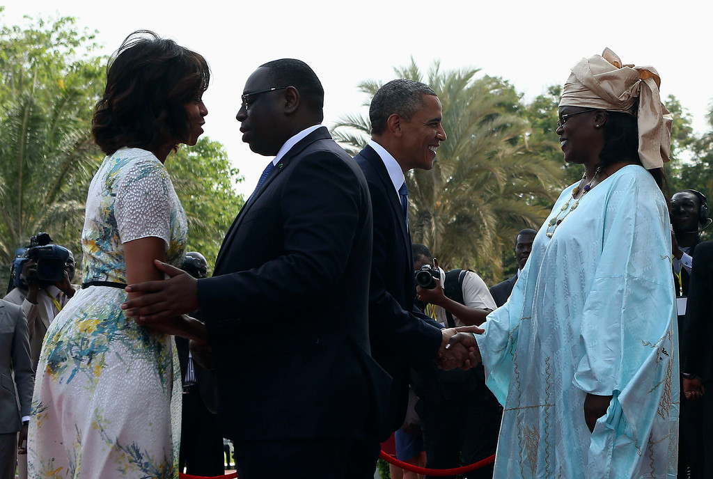 . U.S. President Barack Obama (2nd R) and first lady Michelle Obama (L) are greeted by Senegal President Macky Sall (2nd L) and his wife Mariame at the Presidential Palace June 27, 2013 in Dakar, Sengal. Obama\'s trip, his second to the continent as president, will take him to Senegal, South Africa and Tanzania.  REUTERS/Gary Cameron