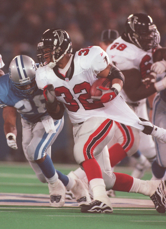 . Atlanta Falcons runningback Jamal Anderson gets pulled down in the fourth quarter of their game against the Detroit Lions.  The Lions get a hand on him enough as Anderson ran for 147 yard on 30 carries. The Falcons beat the Lions 24-17 at the Pontiac Silverdome.