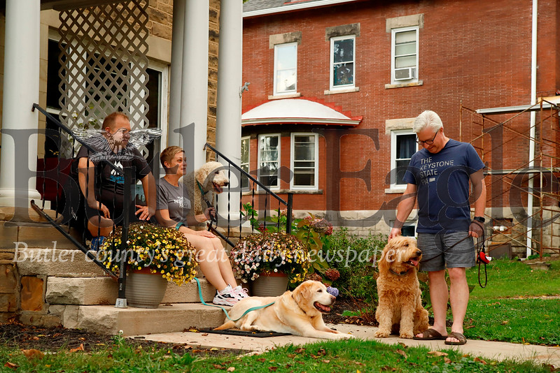 D.J. and Kris Green enjoy an early evening on the front steps of their McKean St. home, chatting  with neighborJohn Mossman. (McKean north of Fulton) Seb Foltz/Butler Eagle