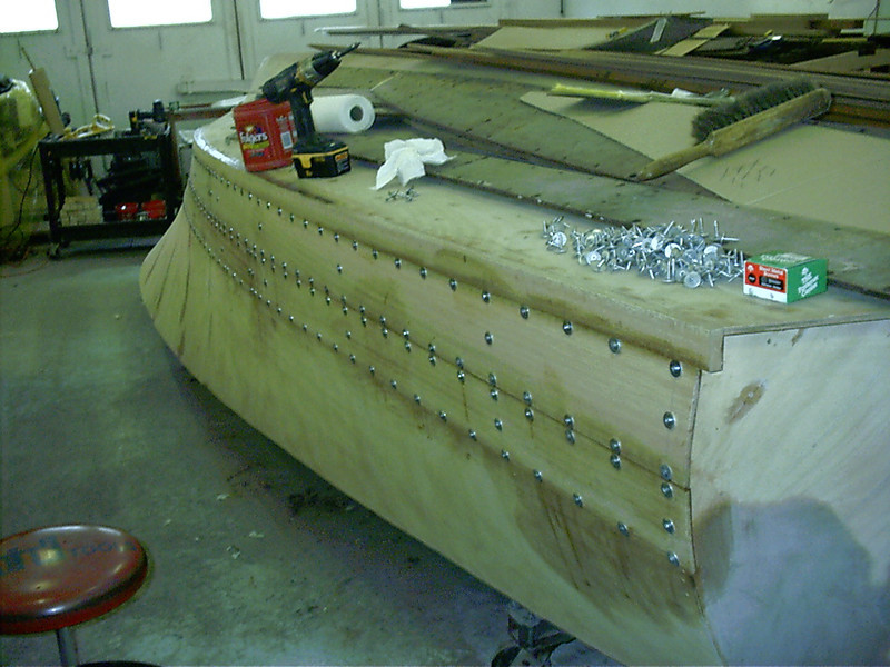 Starboard rear view of first two planks glued and held in place with tempory fasteners.