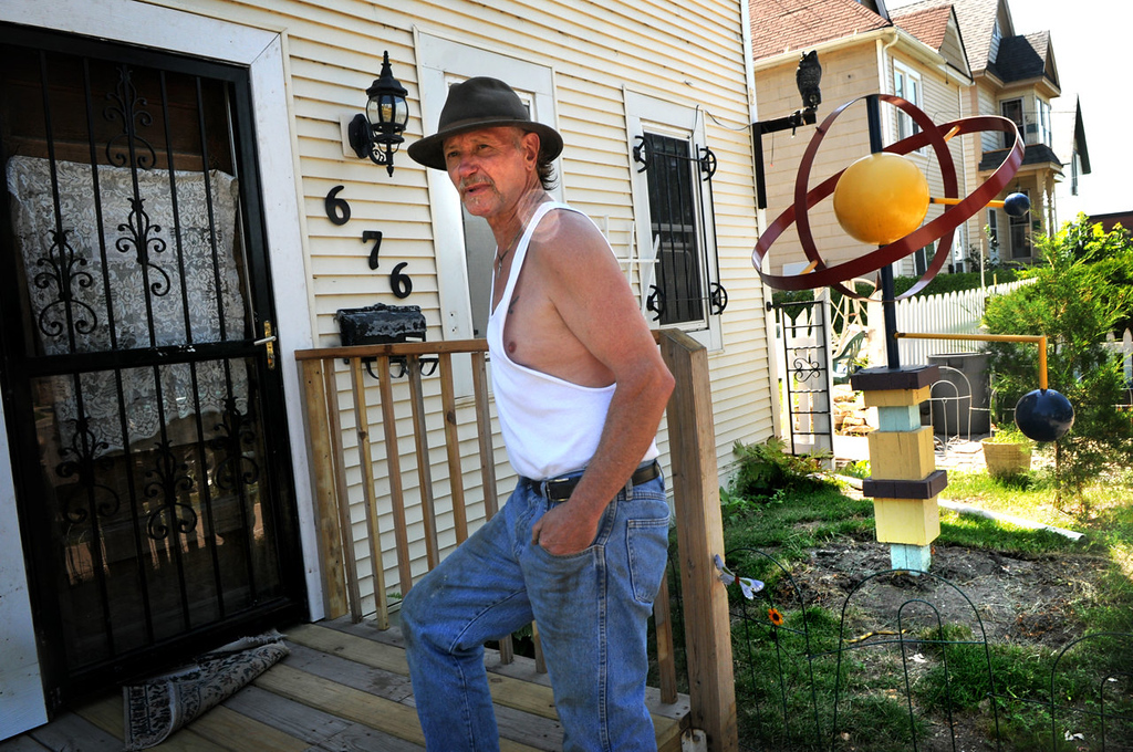 . Arjo Adams walks into his St. Paul home Friday July 19, 2013 which has been condemned.