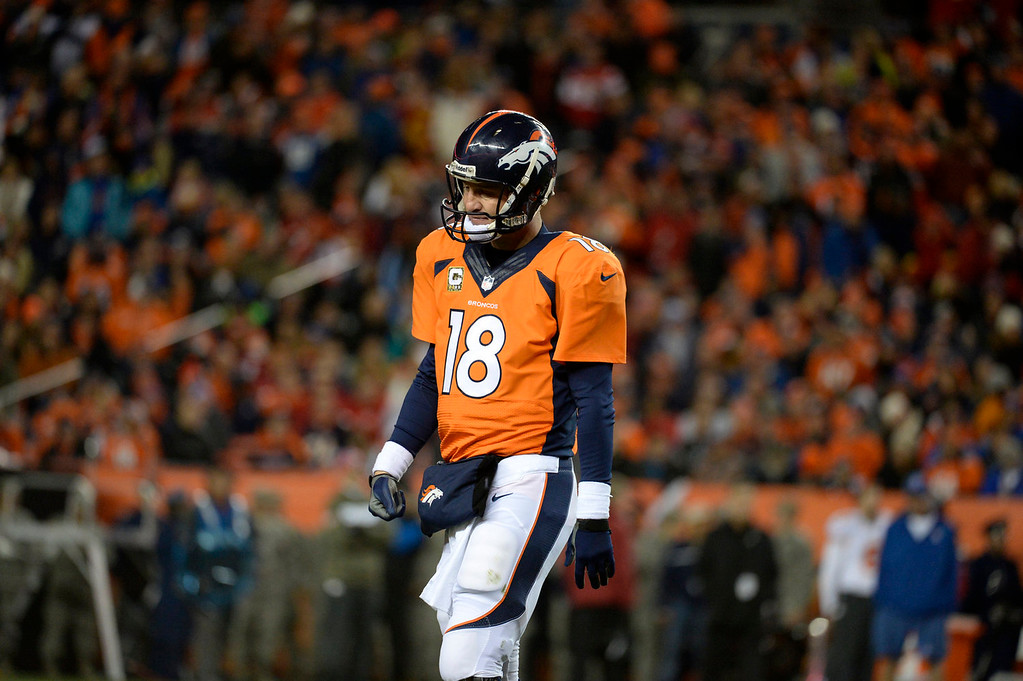 . Denver Broncos quarterback Peyton Manning (18) walks of the field after failing to get into the endzone. The Denver Broncos vs. the Kansas City Chiefs at Sports Authority Field at Mile High in Denver on November 17, 2013. (Photo by Tim Rasmussen/The Denver Post)