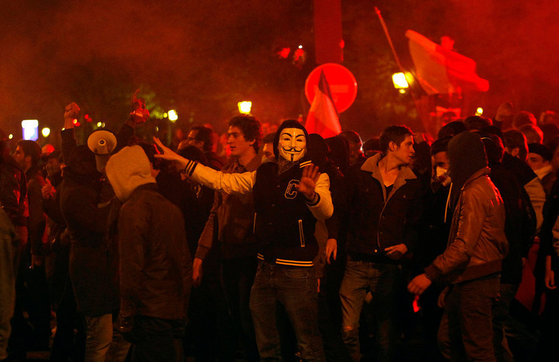. Demonstrators face riot police, Tuesday, April 23, 2013 in Paris. France legalized gay marriage on Tuesday after a wrenching national debate that exposed deep conservatism in the nation\'s heartland and triggered huge demonstrations that tapped into intense discontent with the Socialist government. Within hours, fiery clashes broke out between protesters and riot police. (AP Photo/Christophe Ena)