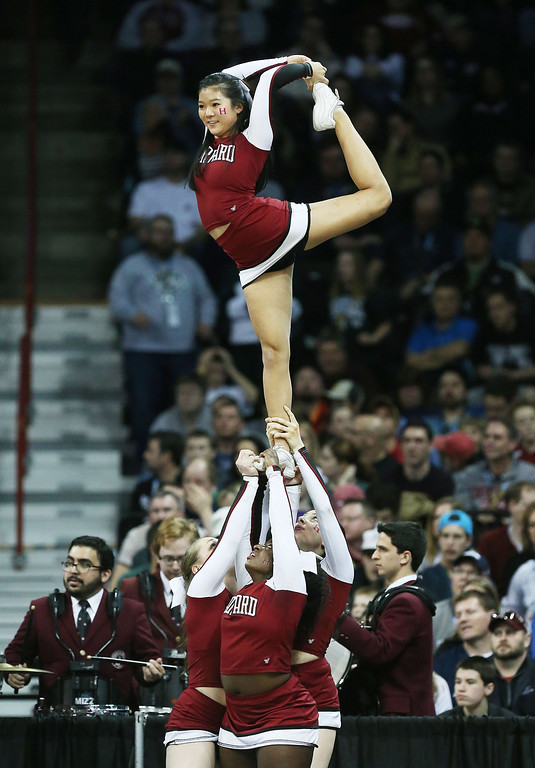. The Harvard Crimson cheerleaders perform against the Michigan State Spartans during the Third Round of the 2014 NCAA Basketball Tournament at Spokane Veterans Memorial Arena on March 22, 2014 in Spokane, Washington.  (Photo by Stephen Dunn/Getty Images)
