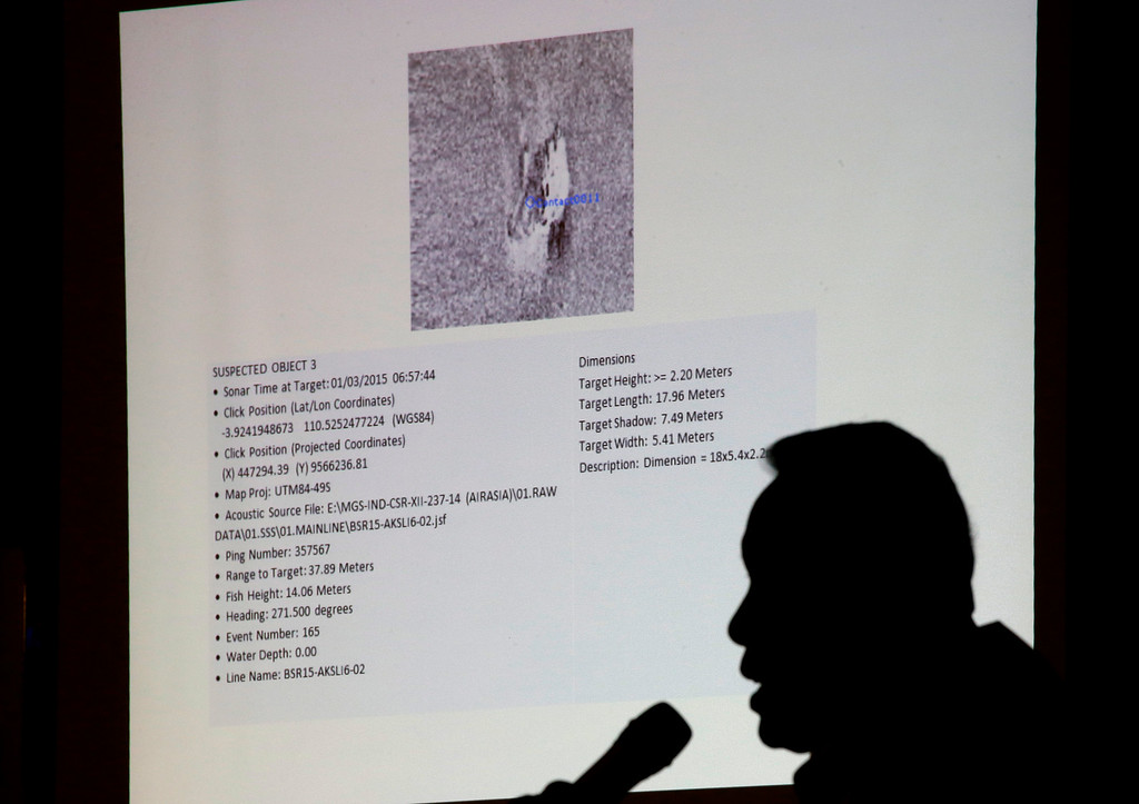 . Chief of National Search And Rescue Agency (BASARNAS) F. Henry Bambang Soelistyo is silhouetted by a projection showing a sonar image of one of the large objects detected on the ocean floor and believed to be part of the wreckage of AirAsia Flight QZ 8501 during a press conference in Jakarta, Indonesia, Saturday, Jan. 3, 2015. Indonesian officials were hopeful Saturday they were honing in on the wreckage of the ill-fated jetliner after sonar equipment detected large objects on the ocean floor, one week after the plane went down in stormy weather. (AP Photo/Dita Alangkara)