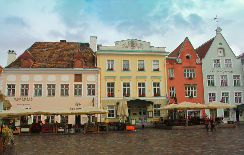 Charming and colorful storefronts line the Town Hall Square -Tallinn, Estonia