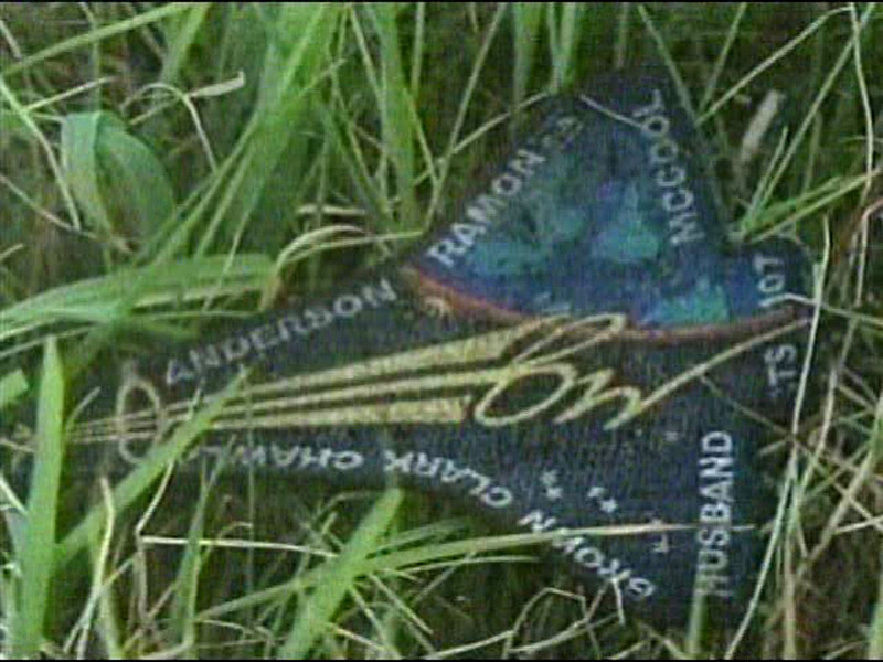 . A crew patch identifying all seven members aboard the space shuttle Columbia, from mission STS-107 is seen in this image from television, Sunday, Feb. 2, 2003 in San Augustine, Texas. Remnants of the space shuttle Columbia remained strewn across east Texas and Louisiana Sunday, as authorities probed possible causes for the tragedy that pierced a crystal blue sky and stung deeper into an already shaken sense of security. (AP Photo/KHOU-TV)
