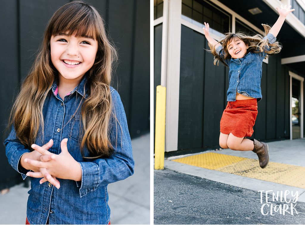Downtown Pleasanton, CA kids model headshots for JE Model by Tenley Clark Photography. Layla jump gray wall.