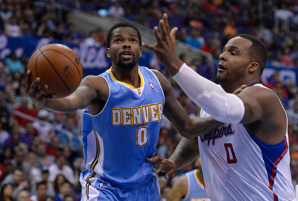 . Denver#0 Aaron Brooks goes to the hoop against Clippers#0 Glen Davis. The Los Angeles Clippers defeated Denver Nuggets 117 to 105 in a regular season NBA game. Los Angeles, CA. 4/15/2014(Photo by John McCoy / Los Angeles Daily News)
