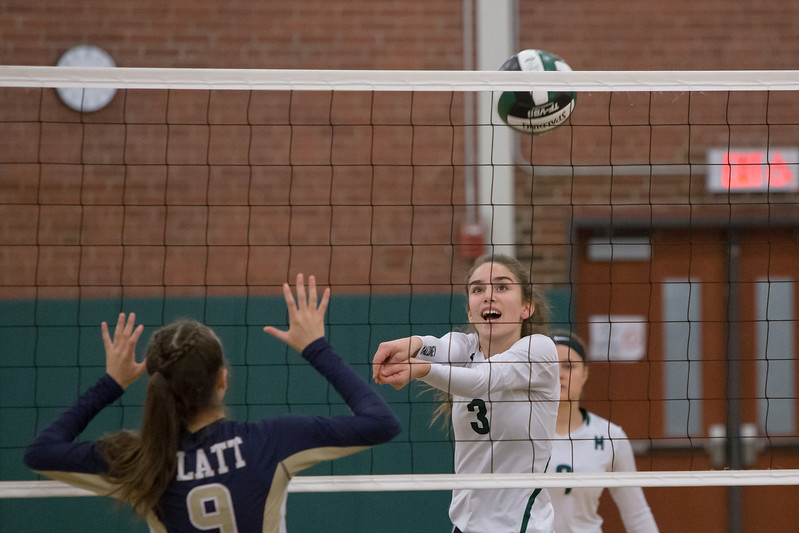 Maloney's Grace Anetrella plays a touch over the net Monday at Maloney High School in Meriden October 2, 2017 | Justin Weekes / For the Record-Journal