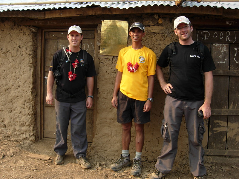 Scott, Roshan & Mads, stand in front of the school at Jyandala shortly after its completion in 2007.