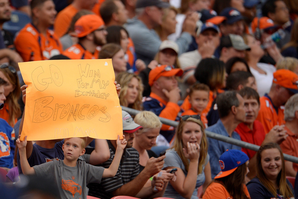. DENVER, CO. - August 24: A young Denver Broncos fan holds a sign in the stands during the first half of action. The Denver Broncos vs the St. Louis Rams during the 3rd pre-season game of the season at Sports Authority Field at Mile High. August 24, 2013 Denver, Colorado. (Photo By Joe Amon/The Denver Post)
