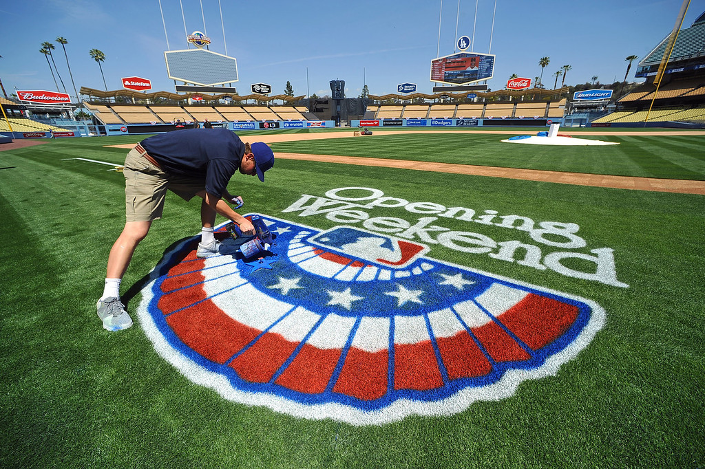 . Dodger Stadium grounds crew member Andrew Hebrard prepares the field for the Opening Weekend series with the Giants Thursday April 3, 2014.(Andy Holzman/Los Angeles Daily News)