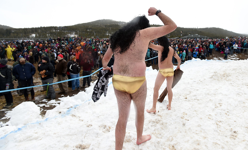 . Danny Duke, left, and Ryan Poe, celebrate their plunge success  on Saturday during 2018 Frozen Dead Guy Days in Nederland. The festival continues on Sunday. For more photos, go to dailycamera.com. Cliff Grassmick  Photographer  March 10, 2018