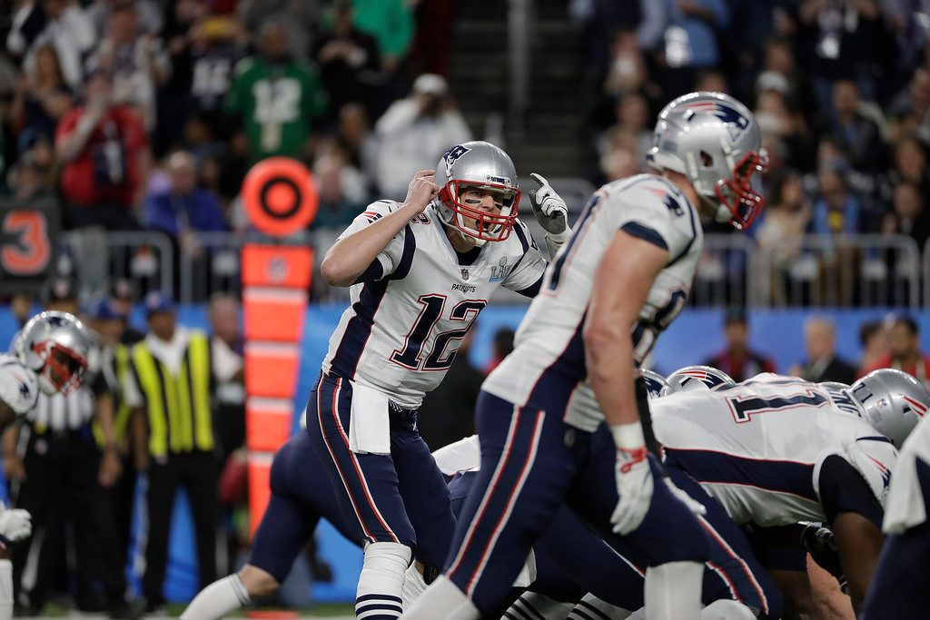 . New England Patriots\' Tom Brady signals during the first half of NFL Super Bowl 52 football game against the Philadelphia Eagles Sunday Feb. 4, 2018, in Minneapolis. (AP Photo/Jeff Roberson)