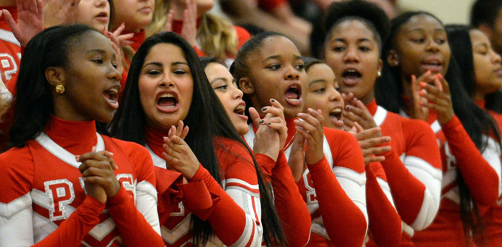 . Pasadena cheerleaders perform during a time-out in the first half of a prep playoff game against Ontario at Pasadena High School in Pasadena, Calif., on Friday, Feb.21, 2014. (Keith Birmingham Pasadena Star-News)