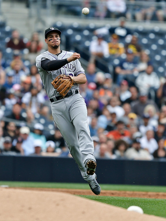. Colorado Rockies third baseman Nolan Arenado throws out San Diego Padres\' Jedd Gyork for the final out in the third inning of a baseball game Thursday, April 17, 2014, in San Diego. (AP Photo/Lenny Ignelzi)