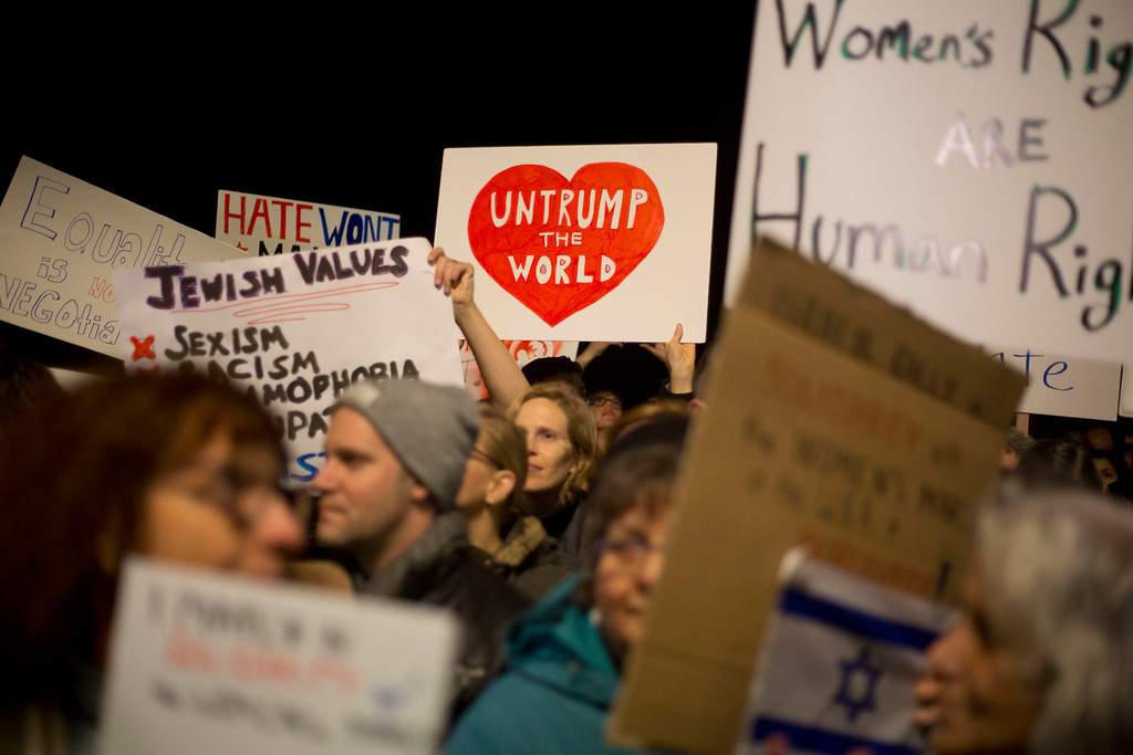 . Demonstrators take part in solidarity with the Women\'s March in Washington following the Inauguration of U.S. President Donald Trump in front of the US embassy in Tel Aviv, Israel, Saturday, Jan. 21, 2017. (AP Photo/Ariel Schalit)
