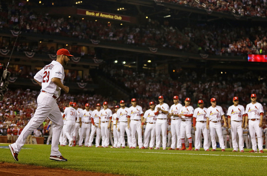 . St. Louis Cardinals\' Chris Carpenter is introduced before Game 1 of the National League baseball championship series against the Los Angeles Dodgers Friday, Oct. 11, 2013, in St. Louis. (AP Photo/Jeff Roberson)