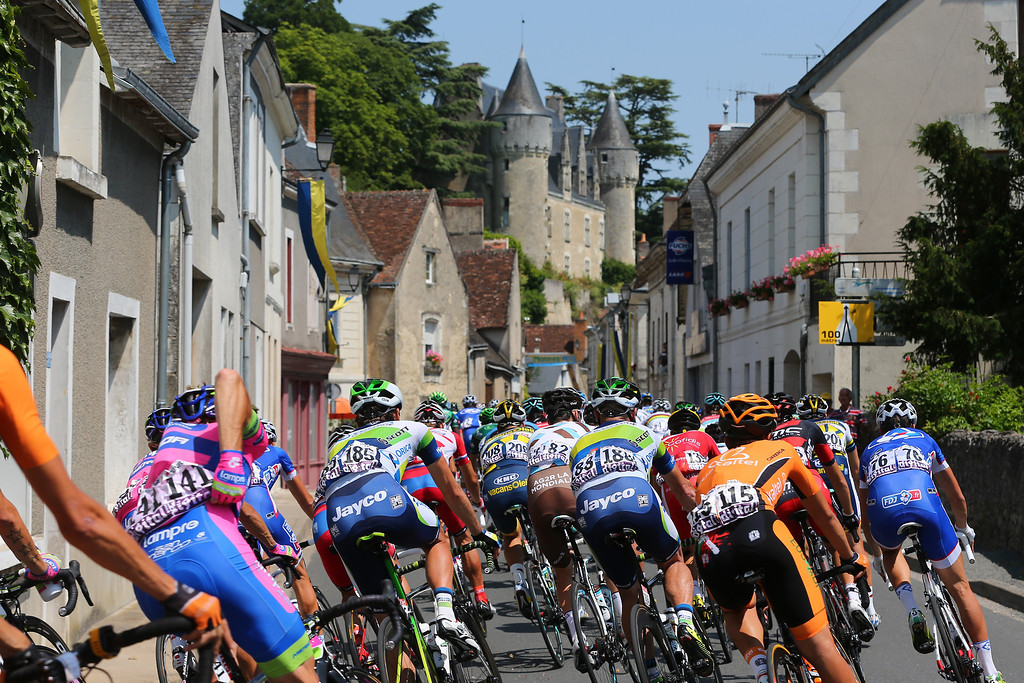 . SAINT-AMAND-MONTROND, FRANCE - JULY 12:  The peloton passes through a village during stage thirteen of the 2013 Tour de France, a 173KM road stage from Tours to Saint-Amand-Montrond on July 12, 2013 in Saint-Amand-Montrond, France.  (Photo by Bryn Lennon/Getty Images)