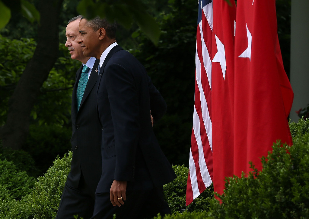 . WASHINGTON, DC - MAY 16:  U.S. President Barack Obama (R) and Prime Minister Recep Tayyip Erdogan of Turkey walk into the Rose Garden to speak to the media at the White House, May 16, 2013 in Washington, DC. President Obama answered questions on the IRS Justice Department invesigation and talked about the situation with Syria.  (Photo by Mark Wilson/Getty Images)