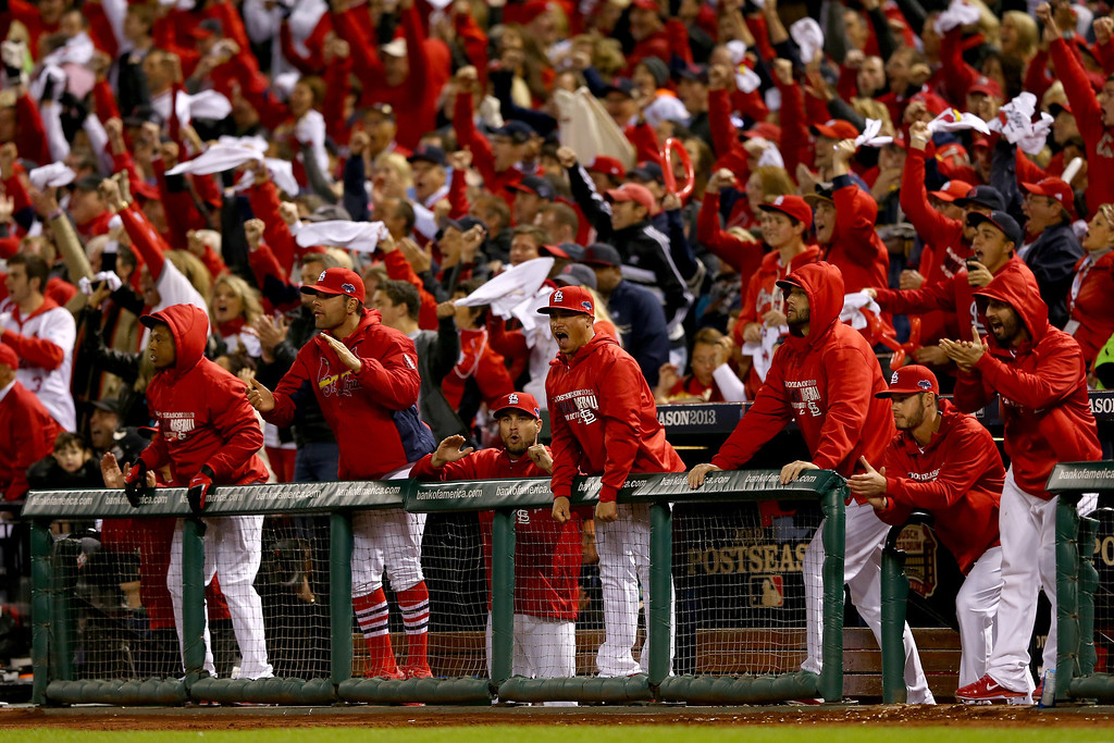 . ST LOUIS, MO - OCTOBER 18:  St. Louis Cardinals players cheer in the third inning while taking on the Los Angeles Dodgers in Game Six of the National League Championship Series at Busch Stadium on October 18, 2013 in St Louis, Missouri.  (Photo by Elsa/Getty Images)