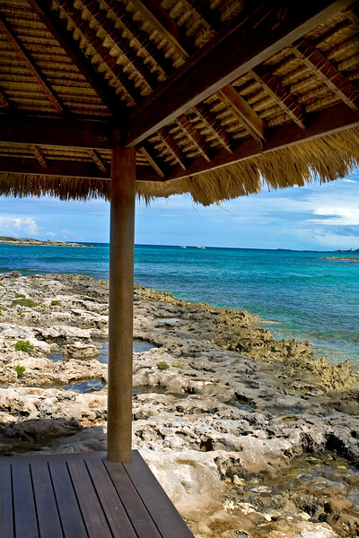 View of tropical lagoon from under a beach hut.