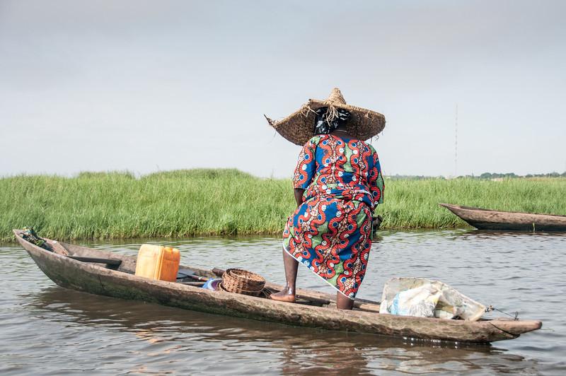 Woman in boat in Cotonou, Benin