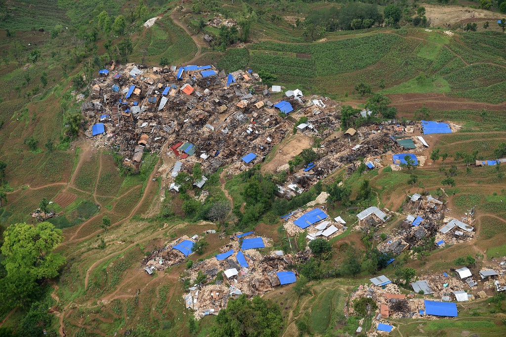 . Damaged houses are pictured from an Indian Army helicopter at Barpak village, in northern-central Gorkha district on April 29, 2015.   Hungry and desperate villagers rushed towards relief helicopters in remote areas of Nepal, begging to be airlifted to safety, four days after a monster earthquake killed more than 5,000 people.    AFP PHOTO / SAJJAD  HUSSAIN/AFP/Getty Images