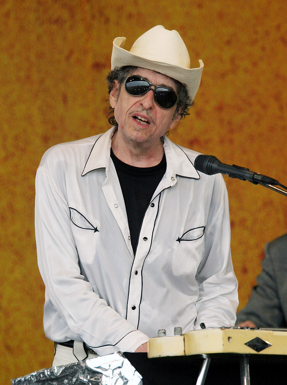 . Bob Dylan performs during the 2006 New Orleans Jazz and Heritage Festival in New Orleans on Friday, April 28, 2006. (AP Photo/Jeff Christensen)
